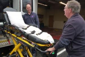 Peninsula Ambulance Corps maneuvers the stretcher into the ambulance