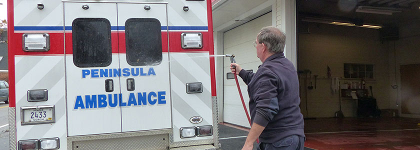 Peninsula Ambulance Corps ambulance gets a wash